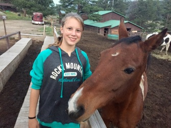 Adrianna and the other girls were constantly visiting the horse stables just down the hill from our campsites
